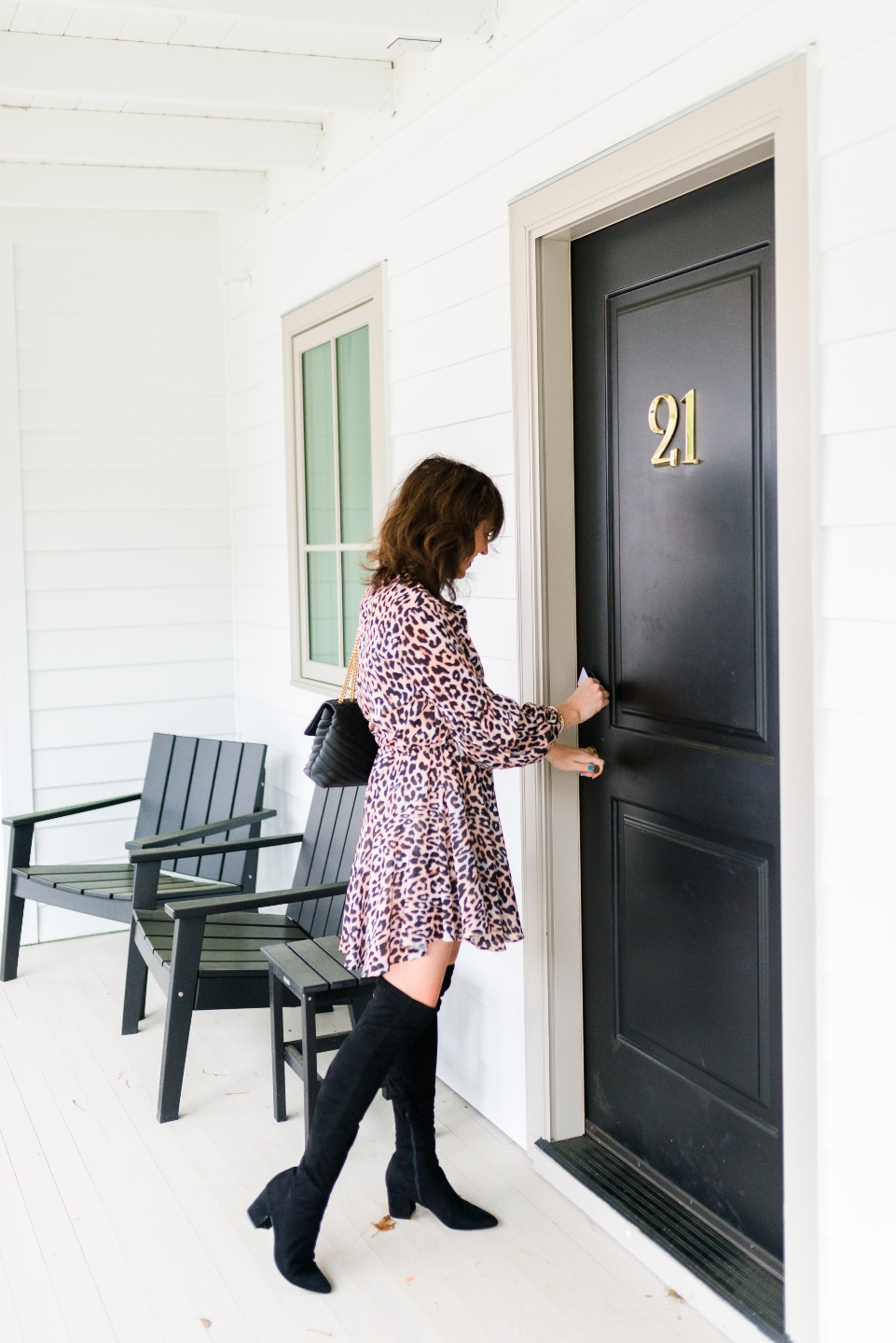Places to Stay: The Colonial Inn in Hillsborough NC - I'm Fixin' To - @imfixintoblog |The Colonial Inn Hillsborough NC by popular NC travel blog, I'm Fixin' To: image of a woman standing in front of a black door with a gold number 21 mounted to it.