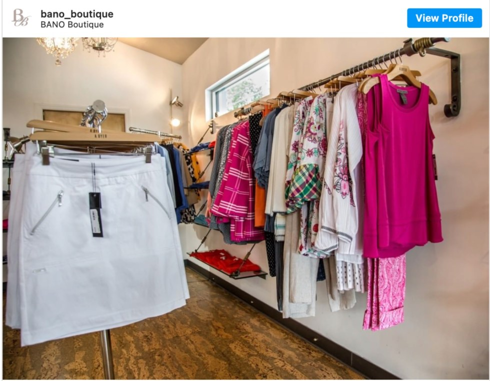 Durham Shopping by popular NC lifestyle blog, I'm Fixin' To: image of clothes hanging on racks in a boutique. .