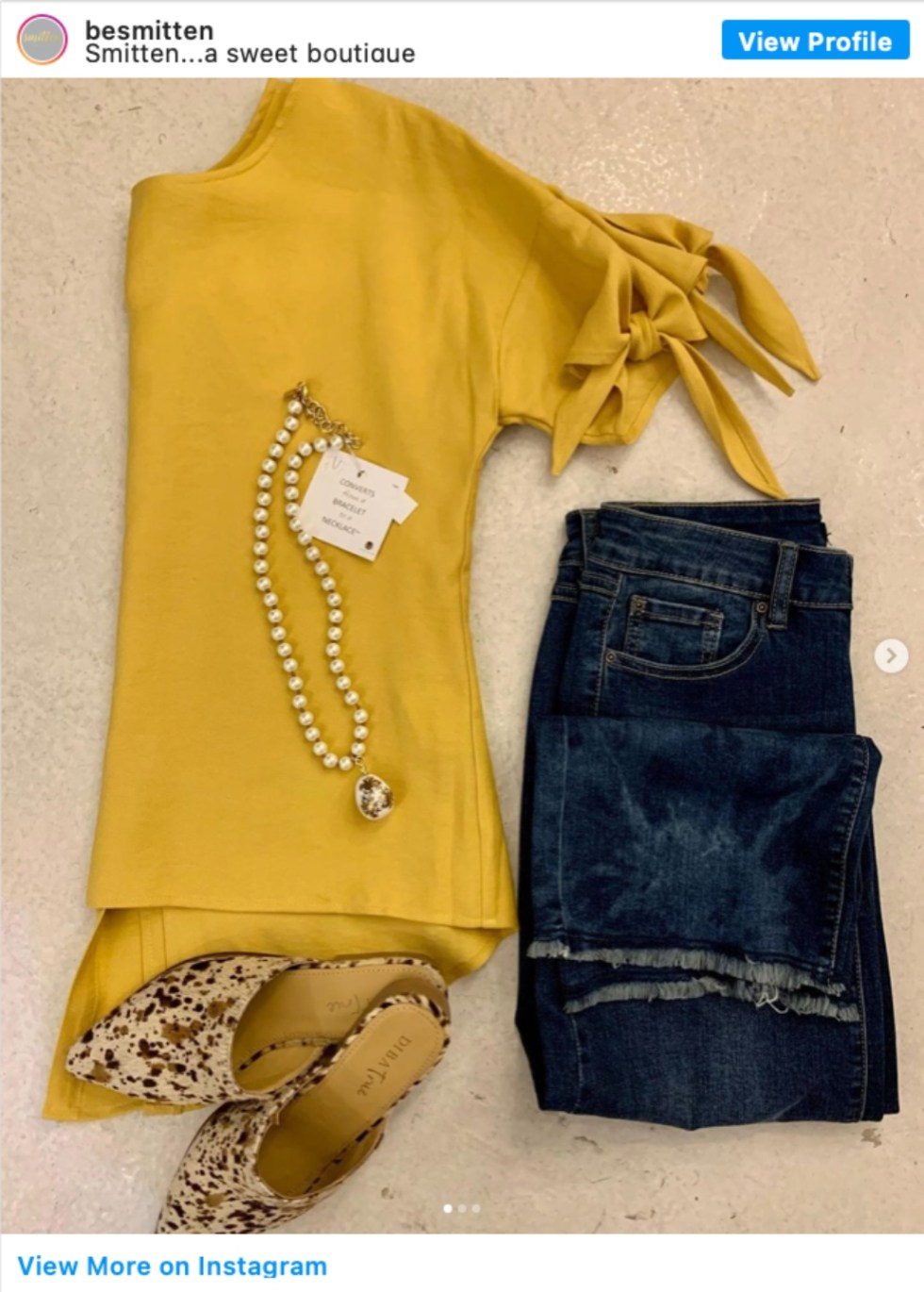 Durham Shopping: Top 11 Best Fashion Boutiques to visit After a Year of Quarantine - I'm Fixin' To - @imfixintoblog | Durham Shopping by popular NC lifestyle blog, I'm Fixin' To: image of a mustard yellow tie sleeve top, jeans, mules and a pearl necklace.