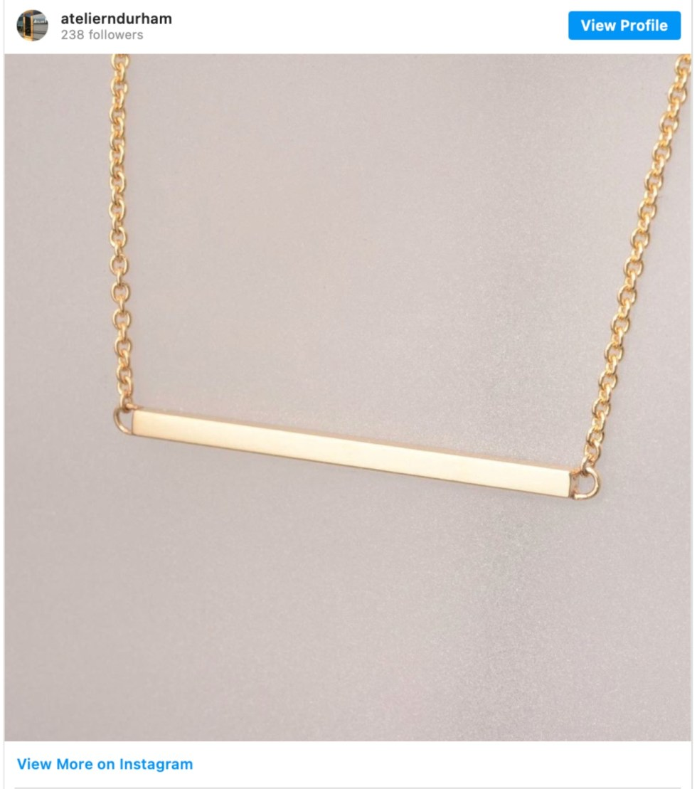 Durham Shopping: Top 11 Best Fashion Boutiques to visit After a Year of Quarantine - I'm Fixin' To - @imfixintoblog | Durham Shopping by popular NC lifestyle blog, I'm Fixin' To: image of a gold bar necklace.