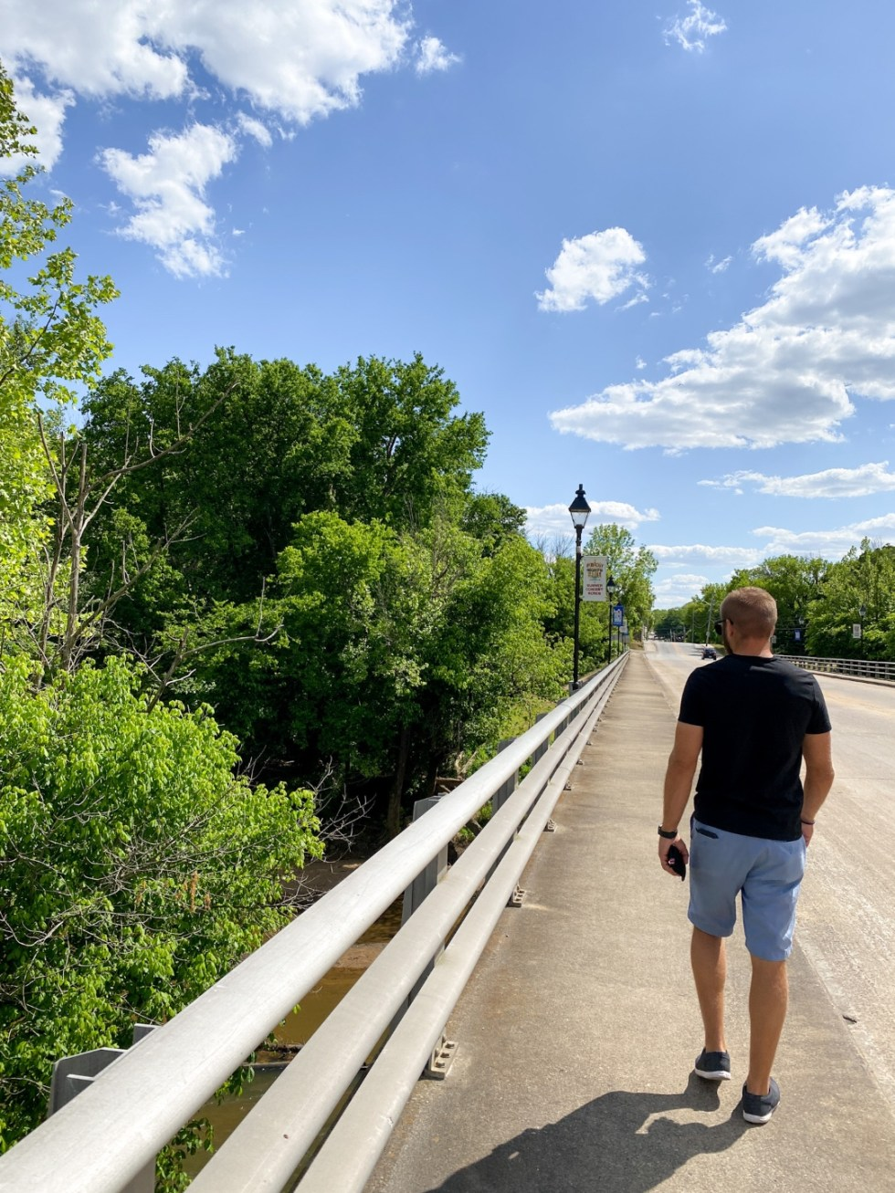 An Afternoon Trip to Franklin County, NC - I'm Fixin' To - @imfixintoblog | Franklin County NC by popular North Carolina travel blog, I'm Fixin' To: image of a man walking on a bridge over a river.
