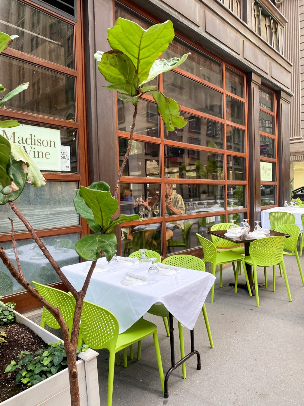 NYC Summer Weekend: Things to Do in NYC in the Summer - I'm Fixin' To - @imfixintoblog   NYC Summer Weekend by popular NC travel blog, I'm Fixin' To: image of outdoor seating at Madison and Vine.