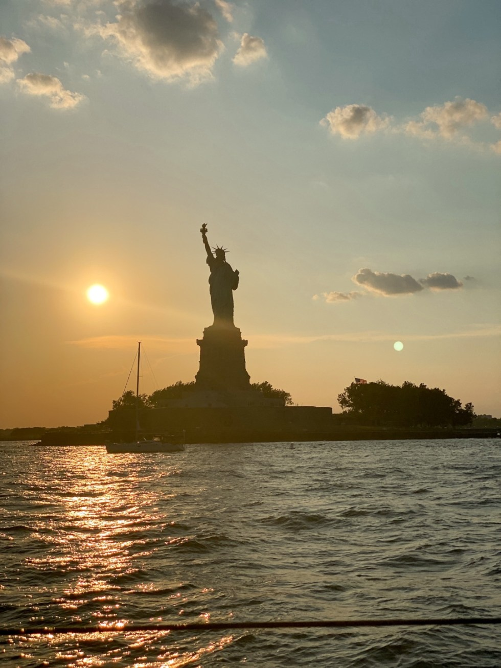 NYC Summer Weekend: Things to Do in NYC in the Summer - I'm Fixin' To - @imfixintoblog   NYC Summer Weekend by popular NC travel blog, I'm Fixin' To: image of the Statue of Liberty.