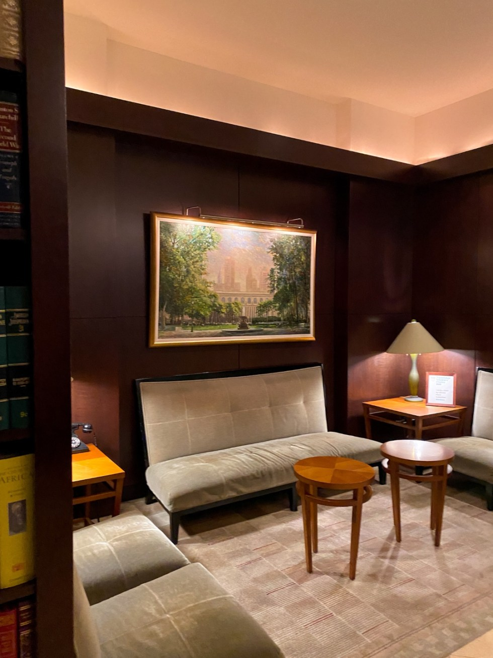 NYC Summer Weekend: Things to Do in NYC in the Summer - I'm Fixin' To - @imfixintoblog   NYC Summer Weekend by popular NC travel blog, I'm Fixin' To: image of a lounge area with grey velvet seating and round coffee tables.