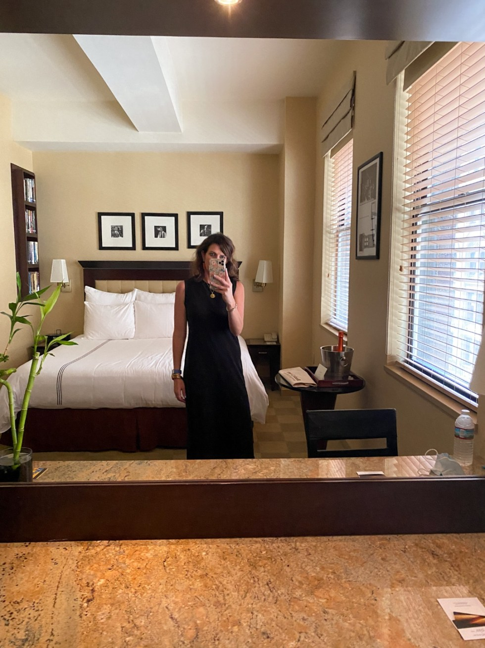 NYC Summer Weekend: Things to Do in NYC in the Summer - I'm Fixin' To - @imfixintoblog   NYC Summer Weekend by popular NC travel blog, I'm Fixin' To: image of a woman wearing a black sleeveless bodycon dress and taking a selfie in a mirror.