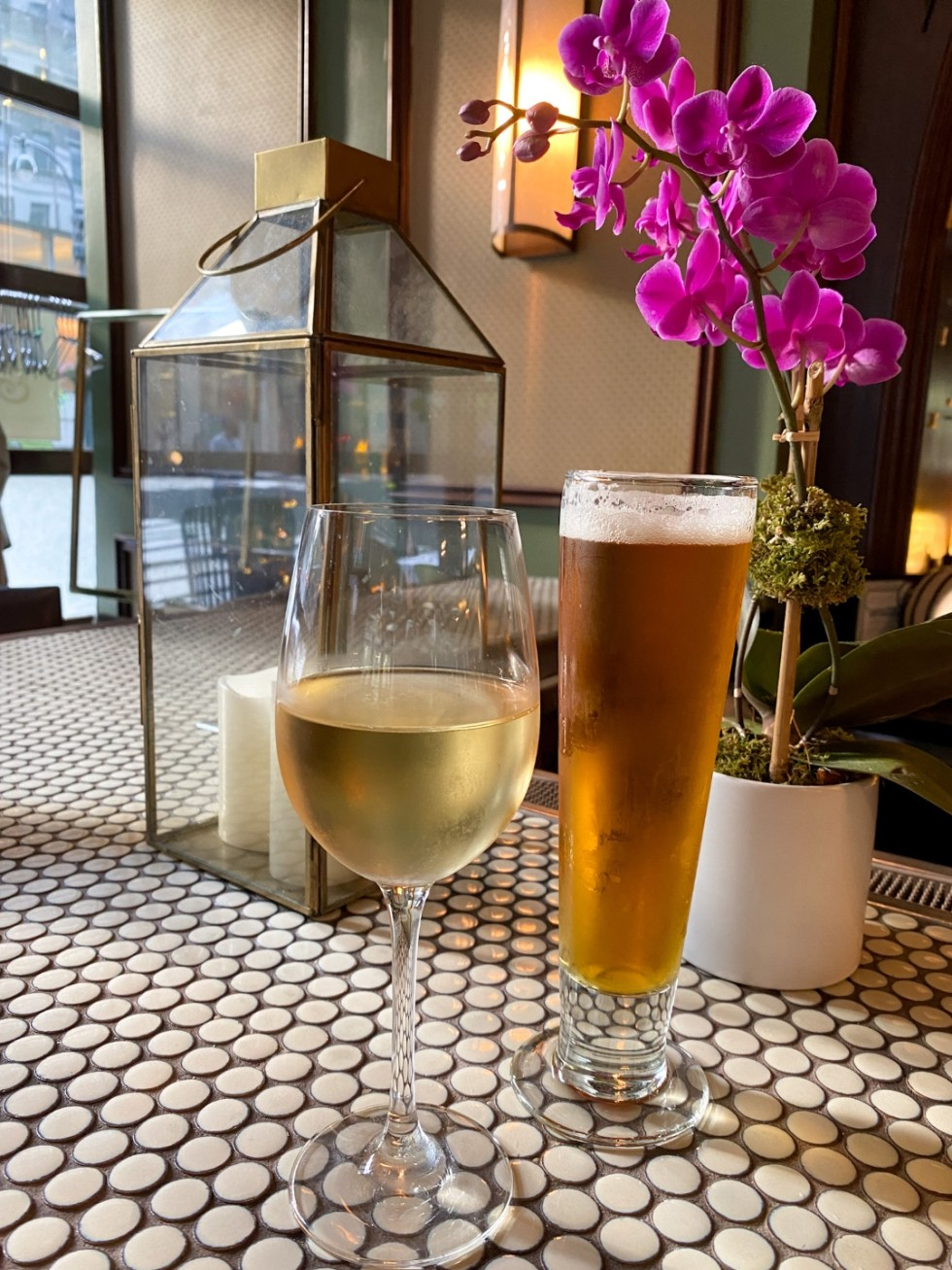NYC Summer Weekend: Things to Do in NYC in the Summer - I'm Fixin' To - @imfixintoblog   NYC Summer Weekend by popular NC travel blog, I'm Fixin' To: image of a glass of white wine and a glass of beer at the Madison and Vine restaurant.