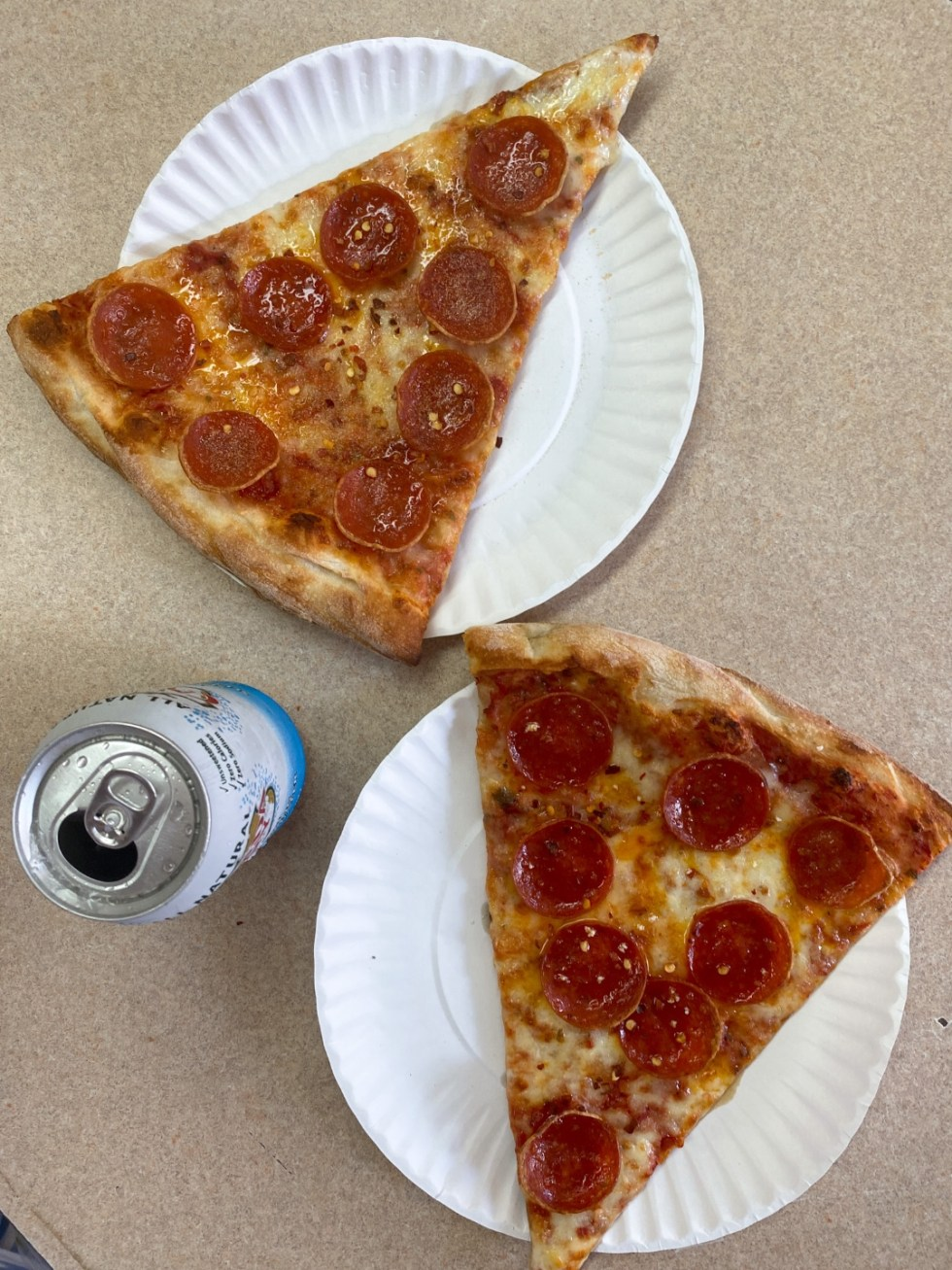 NYC Summer Weekend: Things to Do in NYC in the Summer - I'm Fixin' To - @imfixintoblog   NYC Summer Weekend by popular NC travel blog, I'm Fixin' To: image of two slices of pepperoni pizza.