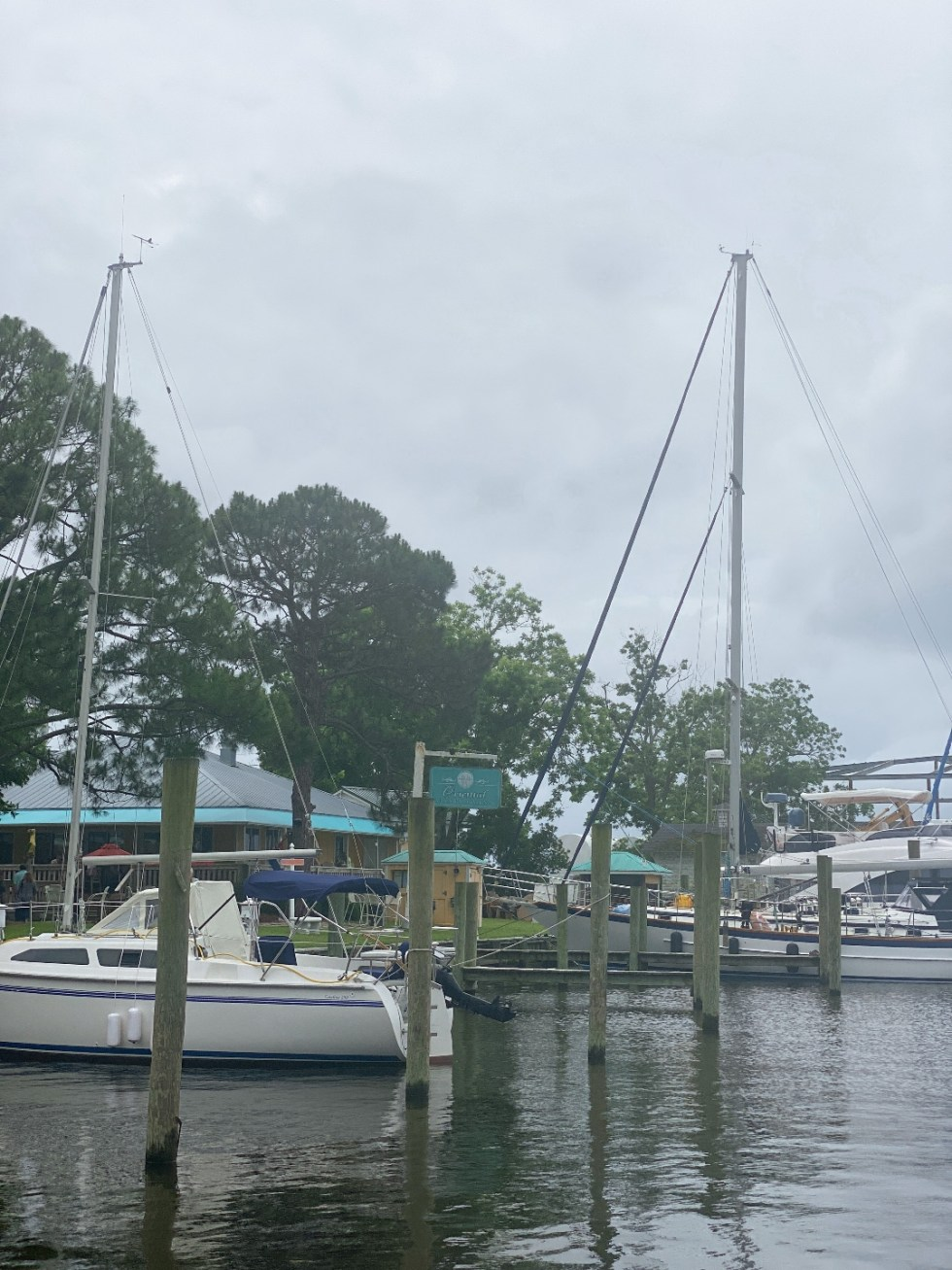 What to Do in Oriental, NC - I'm Fixin' To - @imfixintoblog | Things to do in Oriental NC by popular NC travel blog, I'm Fixin' To: image of the Oriental NC marina filled with sail boats.