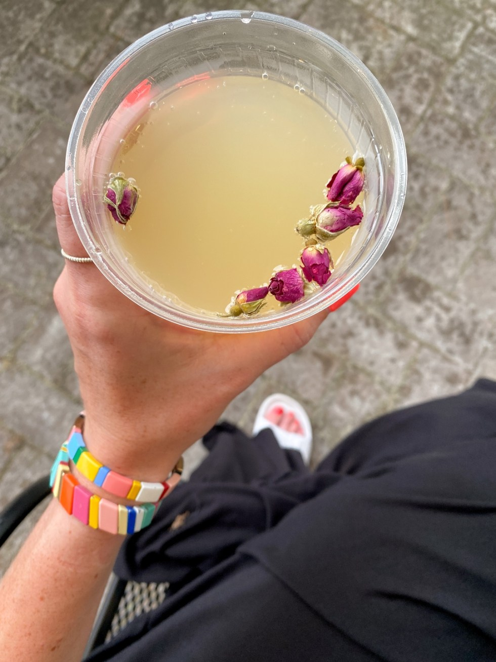 What to Do in Oriental, NC - I'm Fixin' To - @imfixintoblog | Things to do in Oriental NC by popular NC travel blog, I'm Fixin' To: image of a woman holding a cocktail drink in a clear plastic cup.