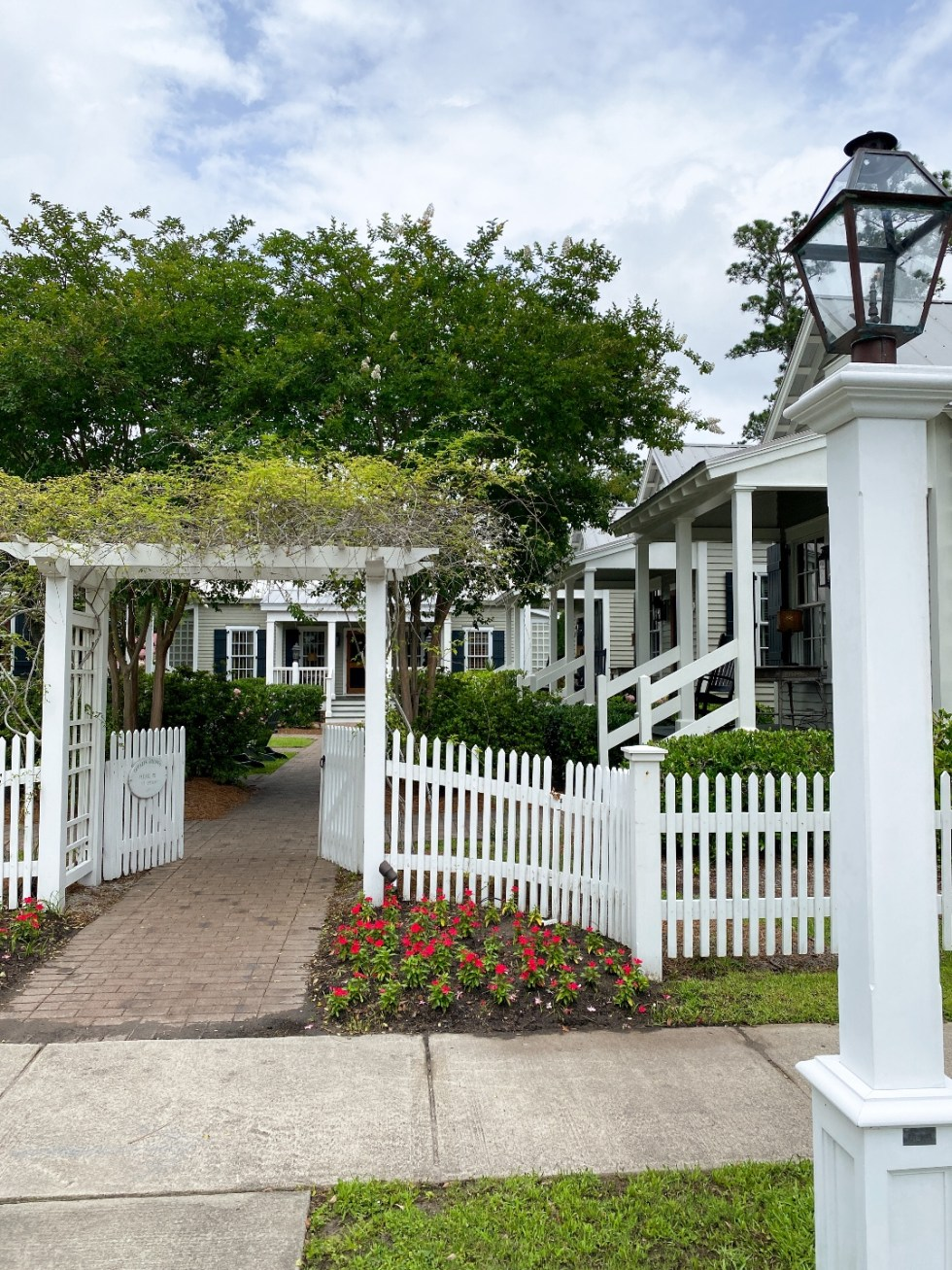 What to Do in Oriental, NC - I'm Fixin' To - @imfixintoblog | Things to do in Oriental NC by popular NC travel blog, I'm Fixin' To: image of a white picket fence.