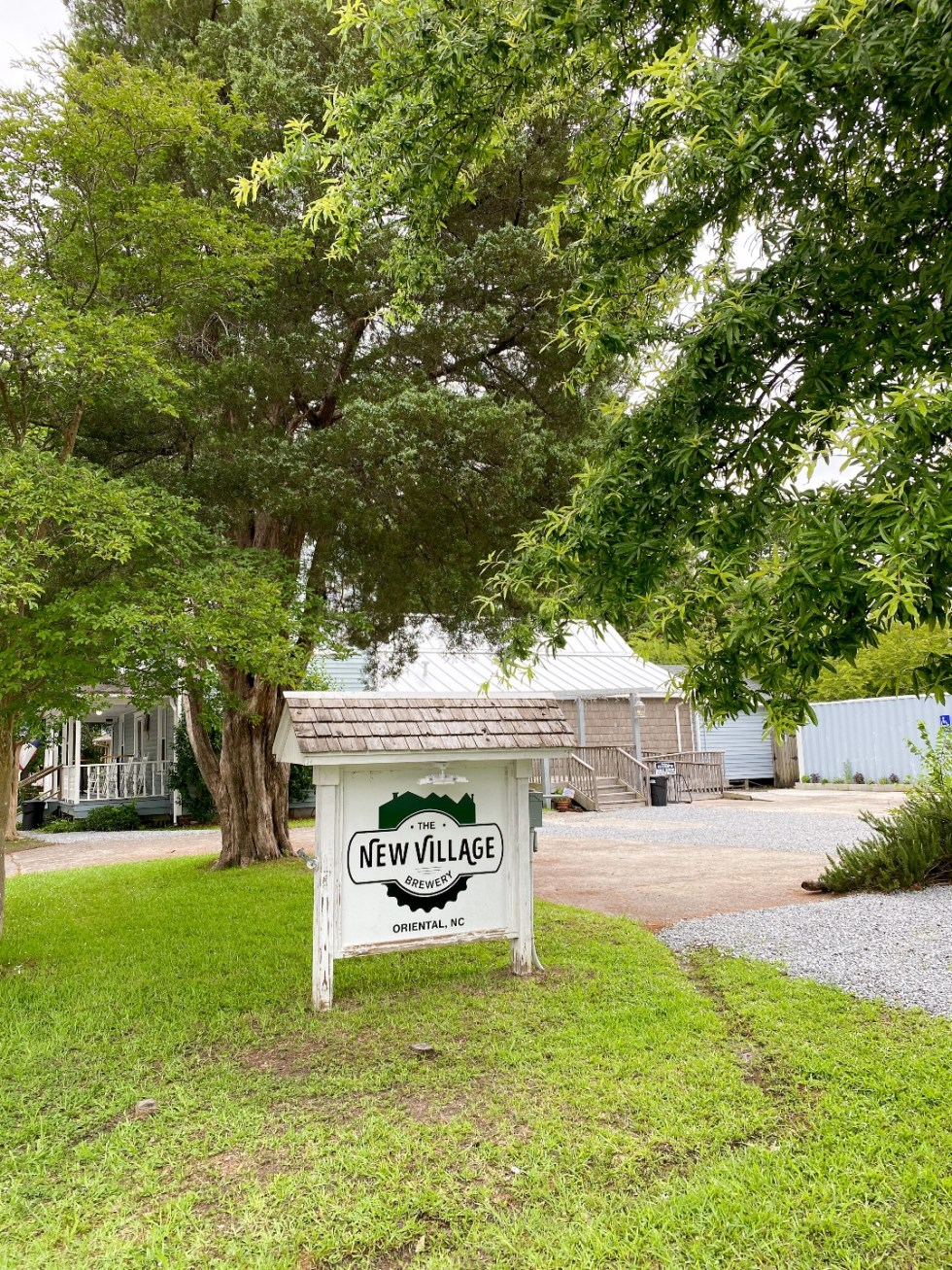 What to Do in Oriental, NC - I'm Fixin' To - @imfixintoblog |. Things to do in Oriental NC by popular NC travel blog, I'm Fixin' To: image of the New Village brewery.
