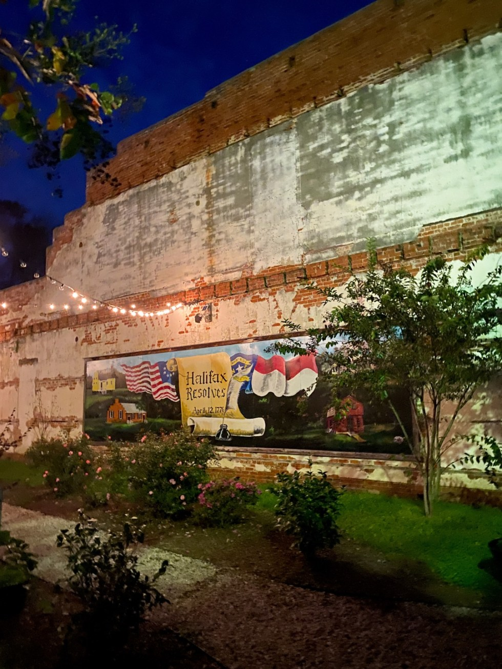 An Update on My North Carolina 100 County Tour - I'm Fixin' To - @imfixintoblog | Things to do in North Carolina by popular NC travel blog, I'm Fixin' To: image of a Halifax wall mural.