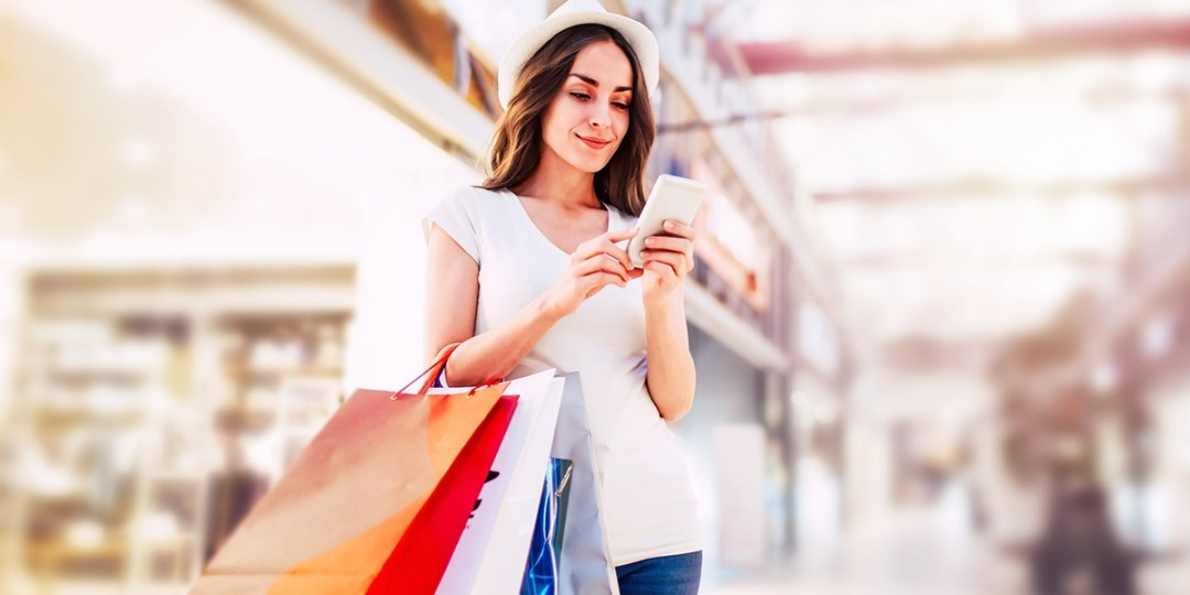 woman using phone to shop using deals and discounts from rewards app