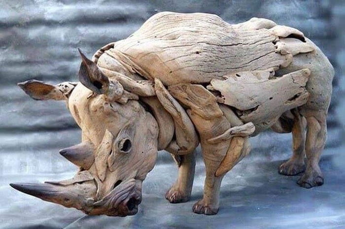 Rhino sculpture made out of driftwood
