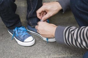 Thera Putty is used to build strength in hands so that tasks such as tying shoes are possible.
