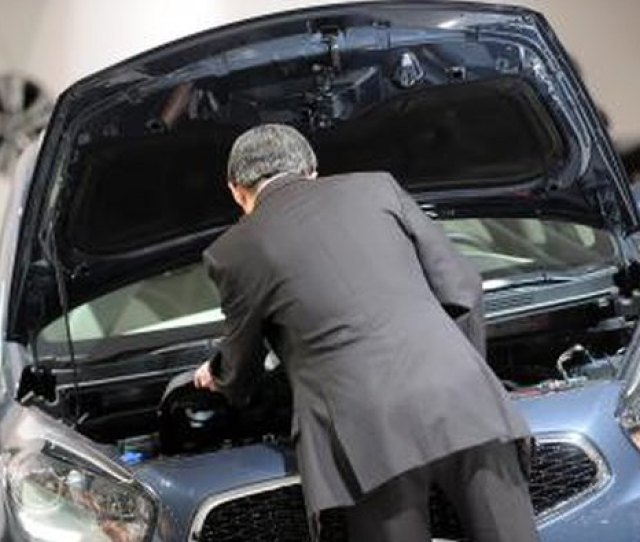Electrical Problems Man Inspects Engine Of A Kia Automobile