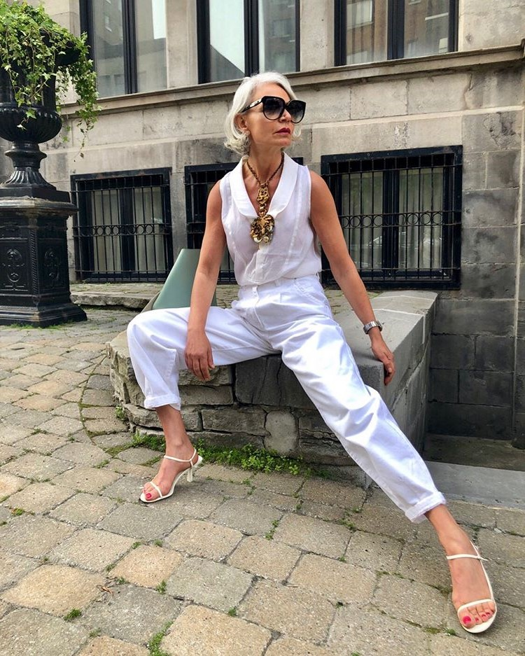 Grece Ghanem white outfit | 12 Over-50 Women With Ridiculously Good Style | Her Beauty