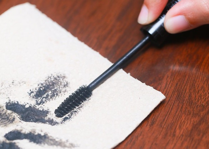 Wipe the brush off before you use it | How To Apply Mascara Like A Pro | Her Beauty