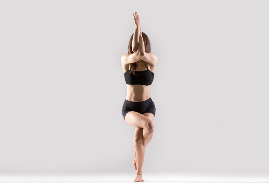 Eagle pose   15 Morning Yoga Poses For Beginners   Her Beauty