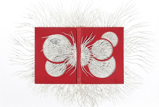 Как делают узоры из изрезанных страниц: филигранное бумажное искусство