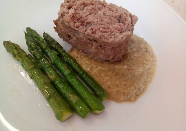Meatloaf with prosciutto, porcini sauce and pan fried asparagus