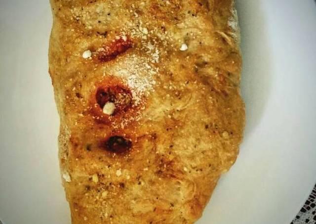 Ground Turkey Stuffed Calzone with garlic buttered crust