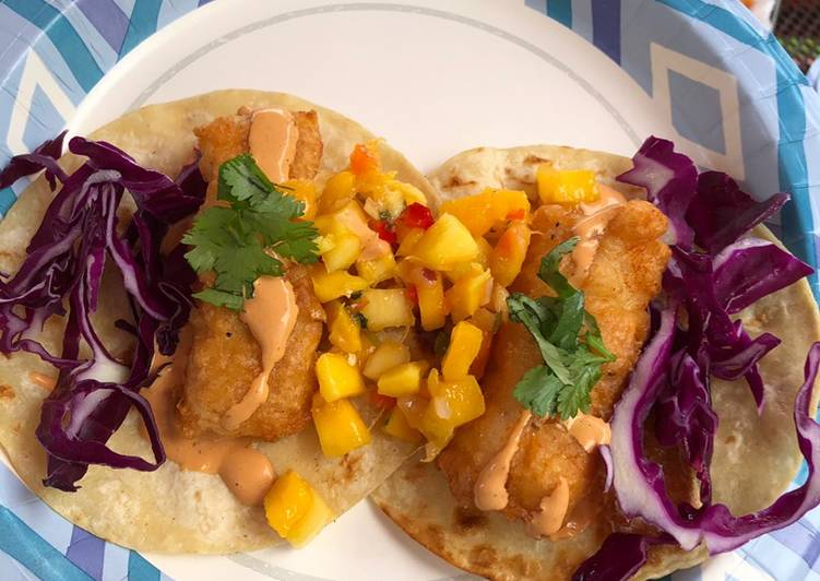 Fish Tacos (beer battered cod w/ mango salsa, chipotle mayo, red cabbage, cilantro)