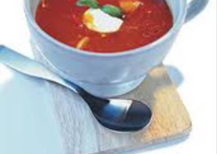 Tomato soup with feta cheese topping