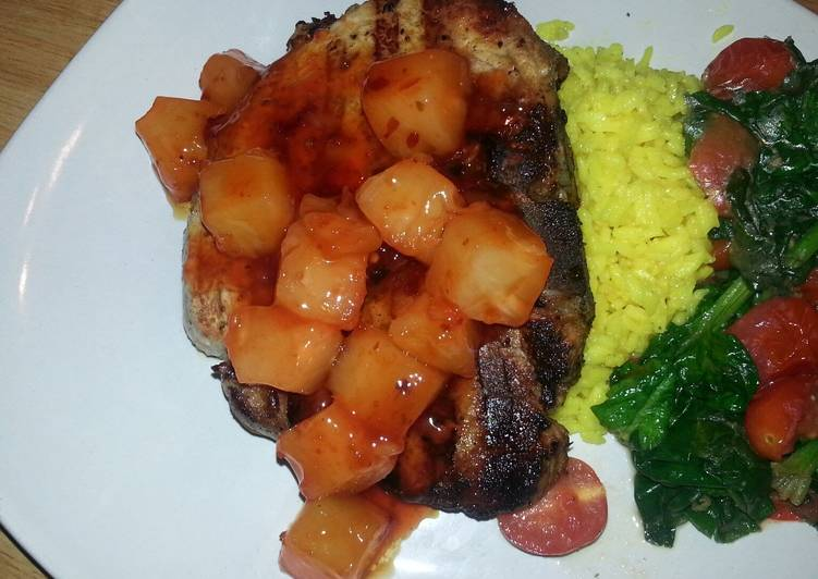 Grilled center cut pork chop with sweet&sour pineapples, saffron rice and garlic spinach tomato saut