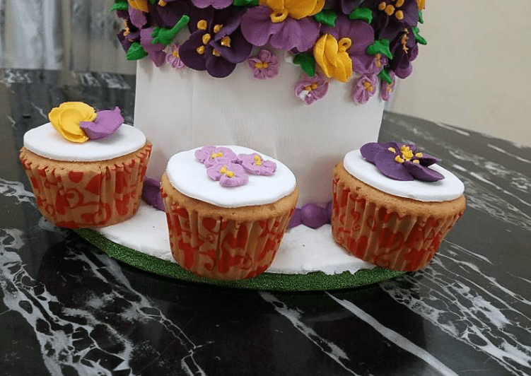 Butter Cake Covered in fondant With Royal icing flowers