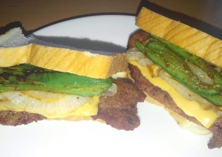 Fried pork chop jalapeno onion and cheese sandwich