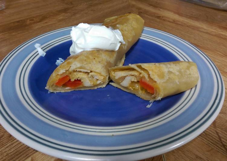 Seasoned Chicken & cheese wrap with bell peppers and sour cream.