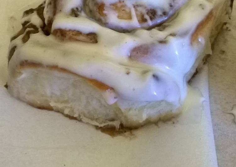 Professional cinnamon rolls topped with cream cheese icing