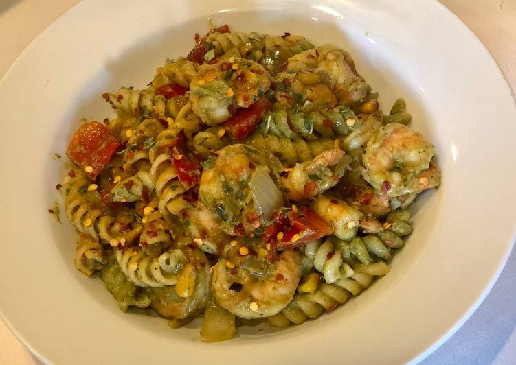 Penne Pasta with Shrimps, fire roasted red peppers, sautéed onions, corn in Avacado Lime Pesto Sauce