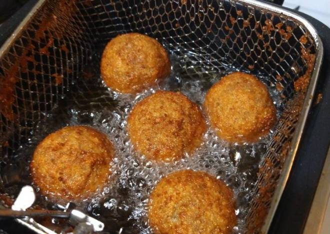 Deep fried Italian meatballs stuffed with cheese curds
