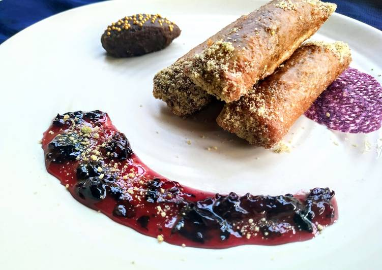 Znoud-el-sit with creamy choco hummus filling and red grape sauce