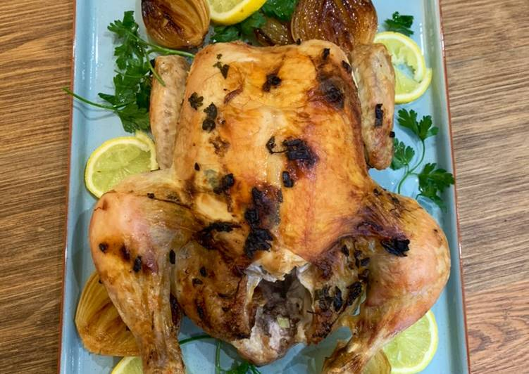Garlic butter roast chicken with caramelised onions