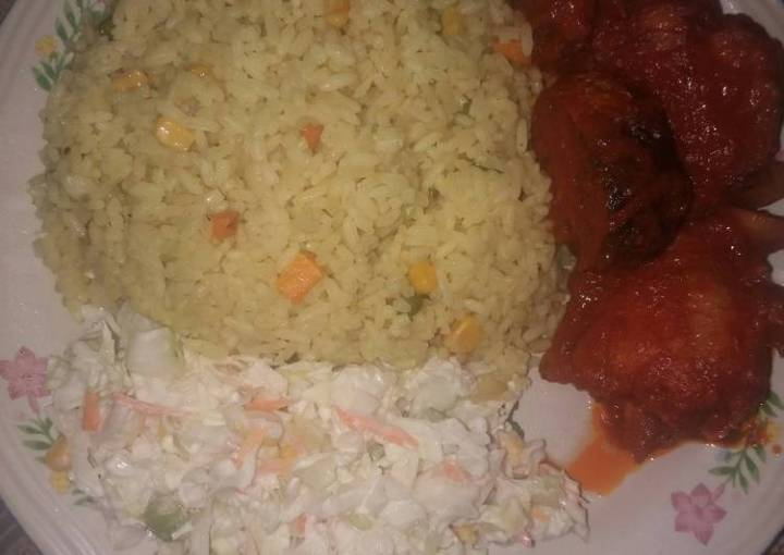 Fried rice and salad with sauced fried turkey and mackerel fish
