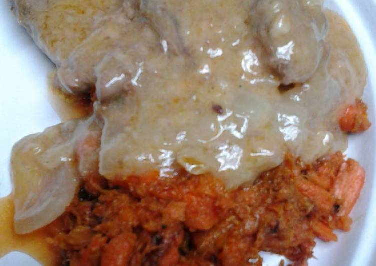 Butter gravy smothered sirloin with mashed carrots