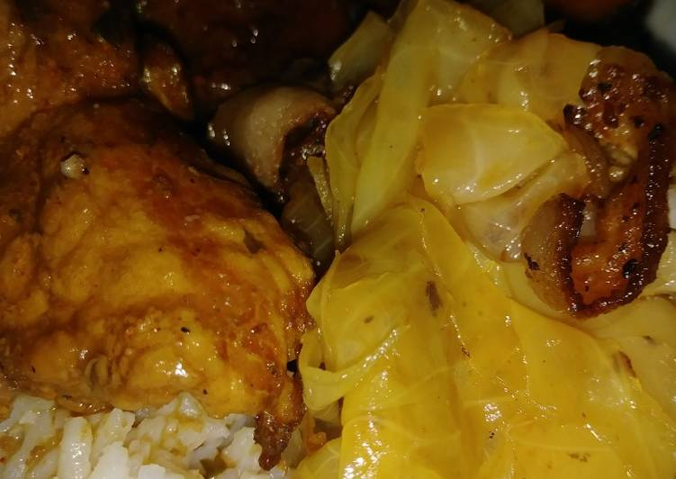 Smothered pork chops, yams and cabbage w/ bacon