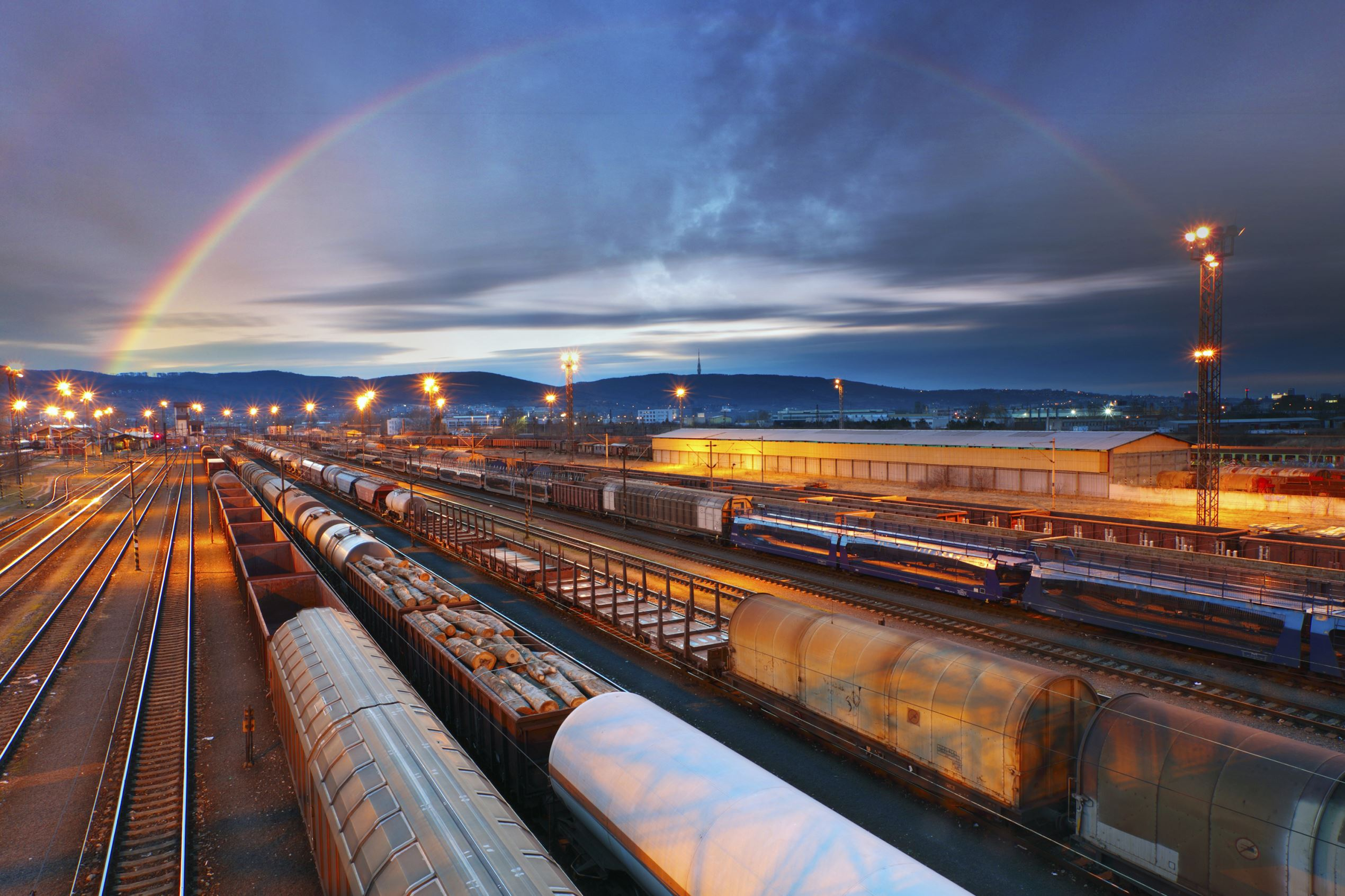 Rainbow over freight train depot.