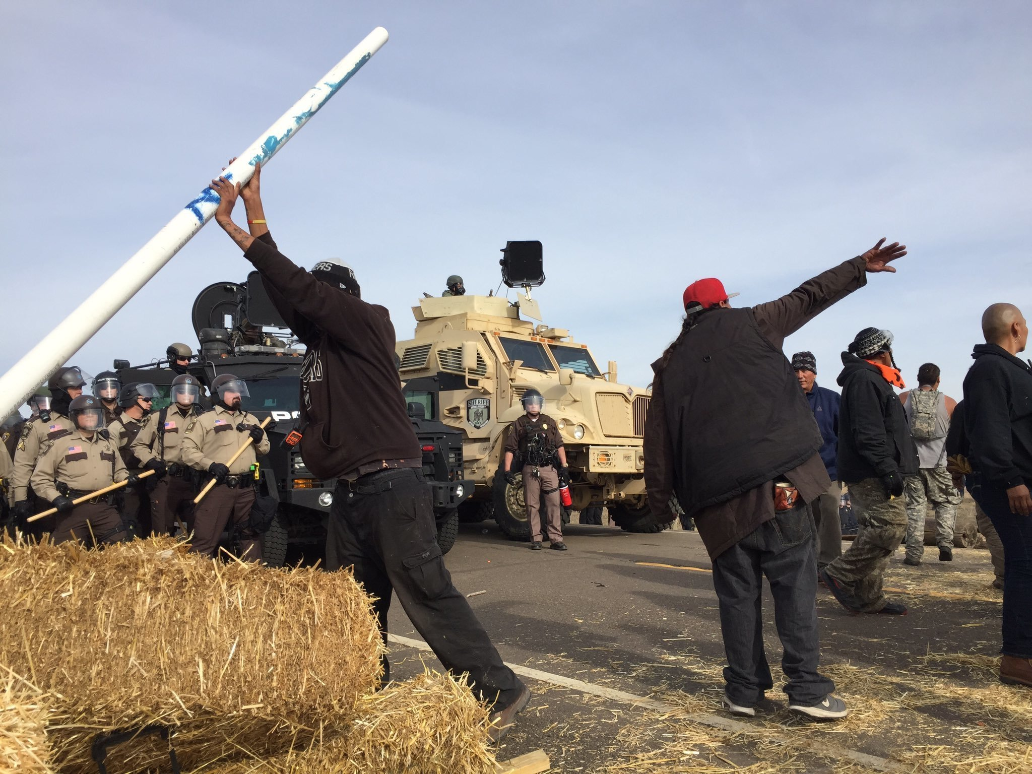 Dakota Access pipeline protesters confront law enforcement on Thursday, Oct. 27, near Cannon Ball, N.D. The months-long dispute over the four-state, $3.8 billion pipeline reached a crisis point when the protesters set up camp on land owned by pipeline developer Energy Transfer Partners. The disputed area is just to the north of a more permanent and larger encampment on federally-owned land where hundreds of protesters have camped for months.
