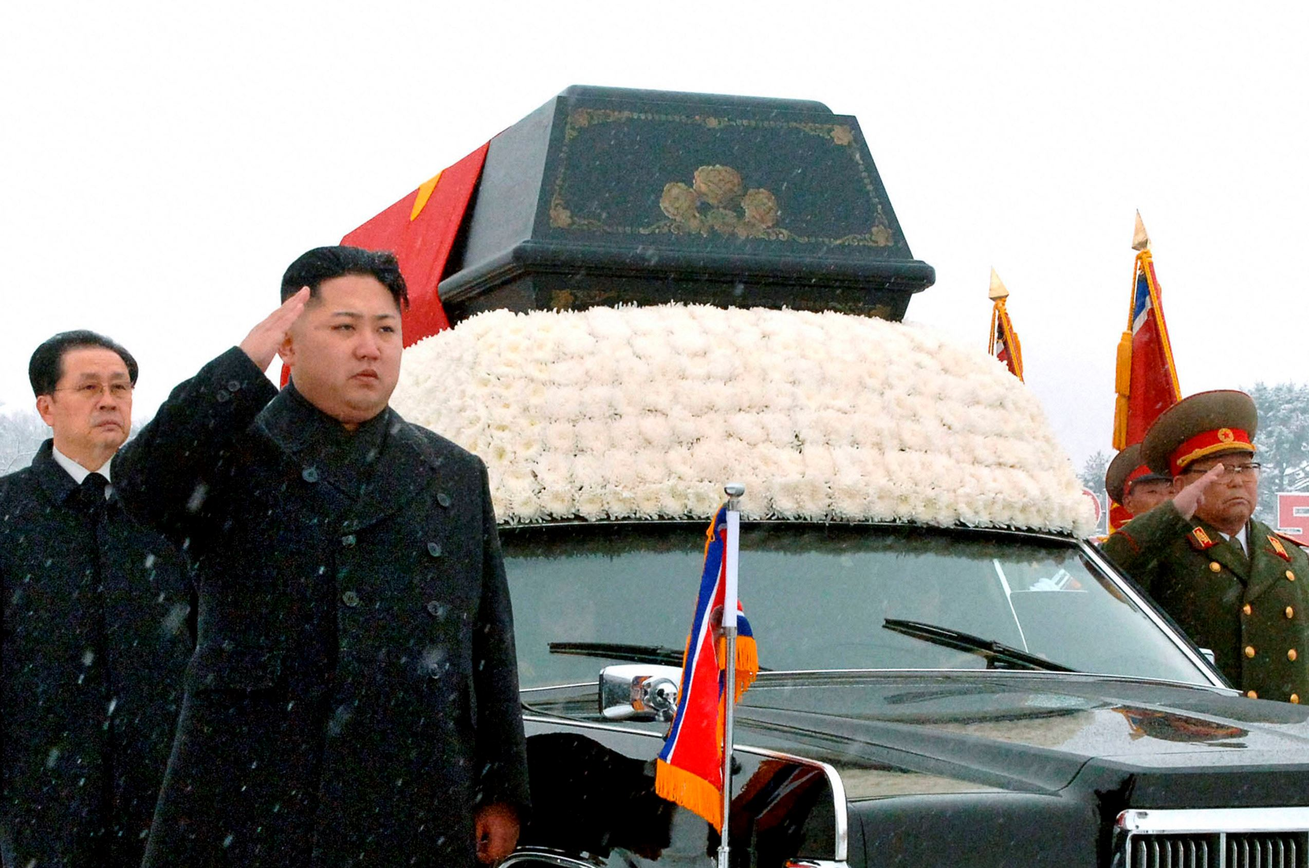 North Korea's new leader Kim Jong Un (2nd L) salutes as he and his uncle Jang Song Thaek (L) accompany the hearse carrying the coffin of late North Korean leader Kim Jong Il during his funeral procession in Pyongyang in this file photo taken by Kyodo December 28, 2011. North Korea said on December 13, 2013 that Jang, previously considered the second most powerful man in the secretive state, has been executed for treason, the biggest upheaval since the death of Kim's father two years ago.