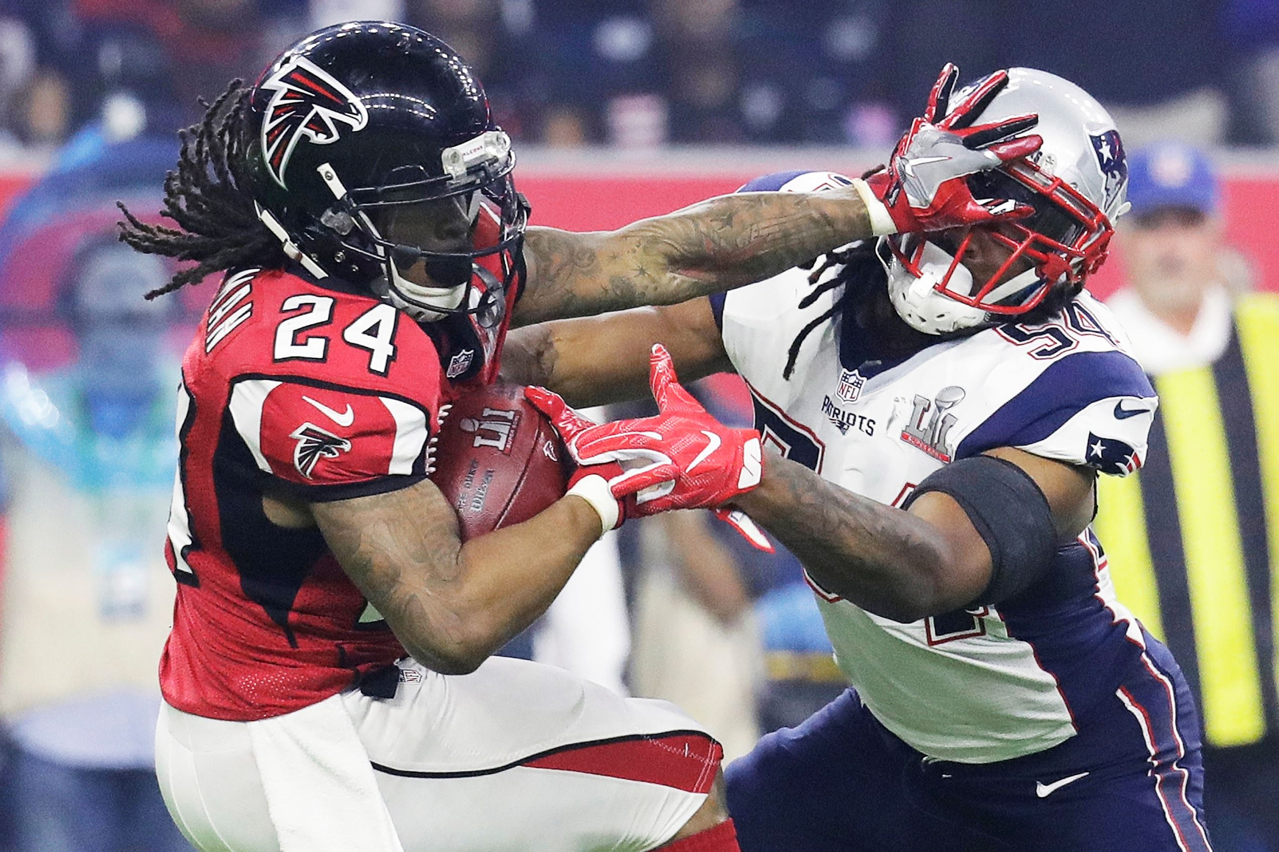 Slide 4 of 29: Atlanta Falcons' Devonta Freeman runs against New England Patriots' Dont'a Hightower during the second half of the NFL Super Bowl 51 football game, on Feb. 5, in Houston.
