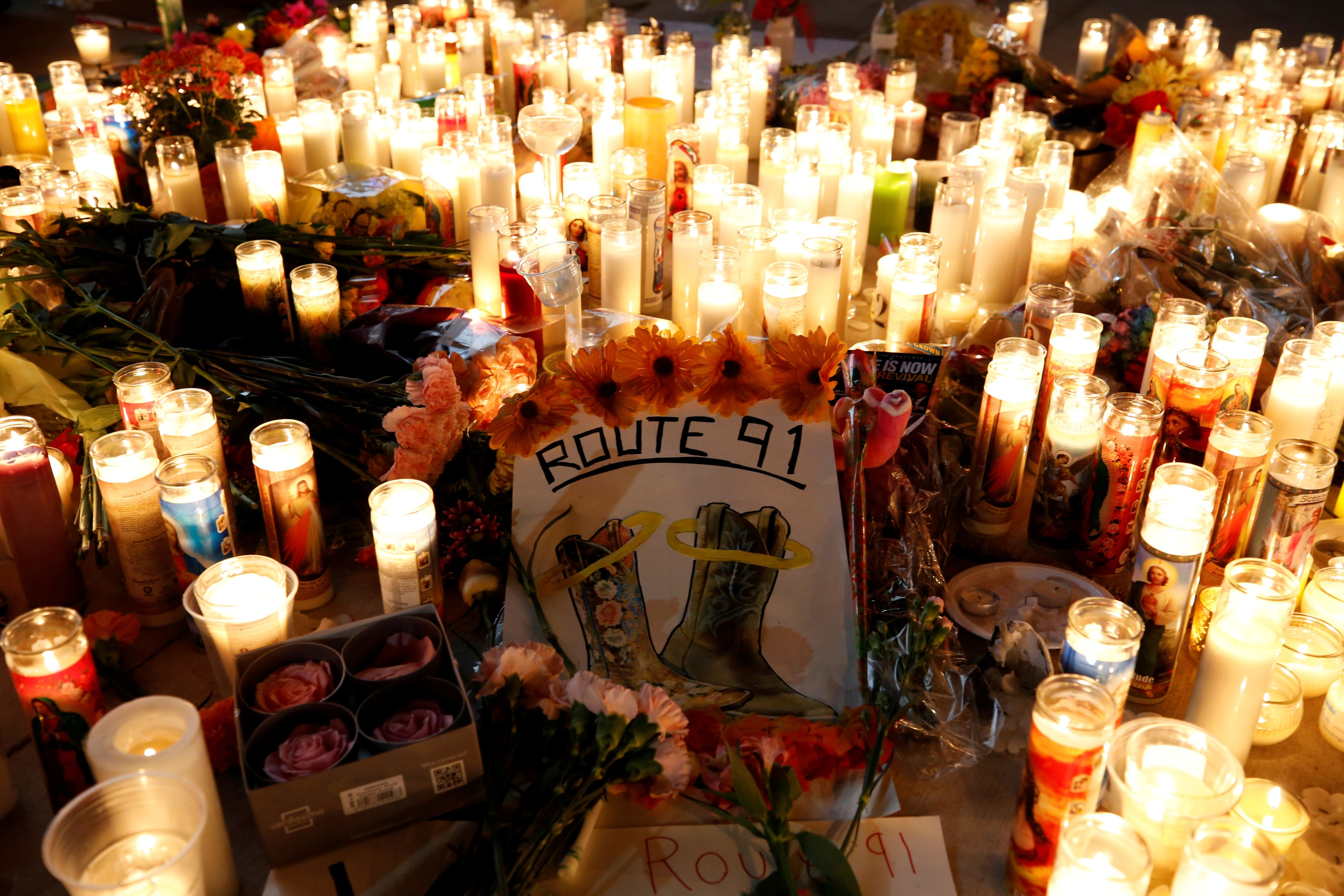 Slide 1 of 31: A candlelight vigil is pictured on the Las Vegas strip.