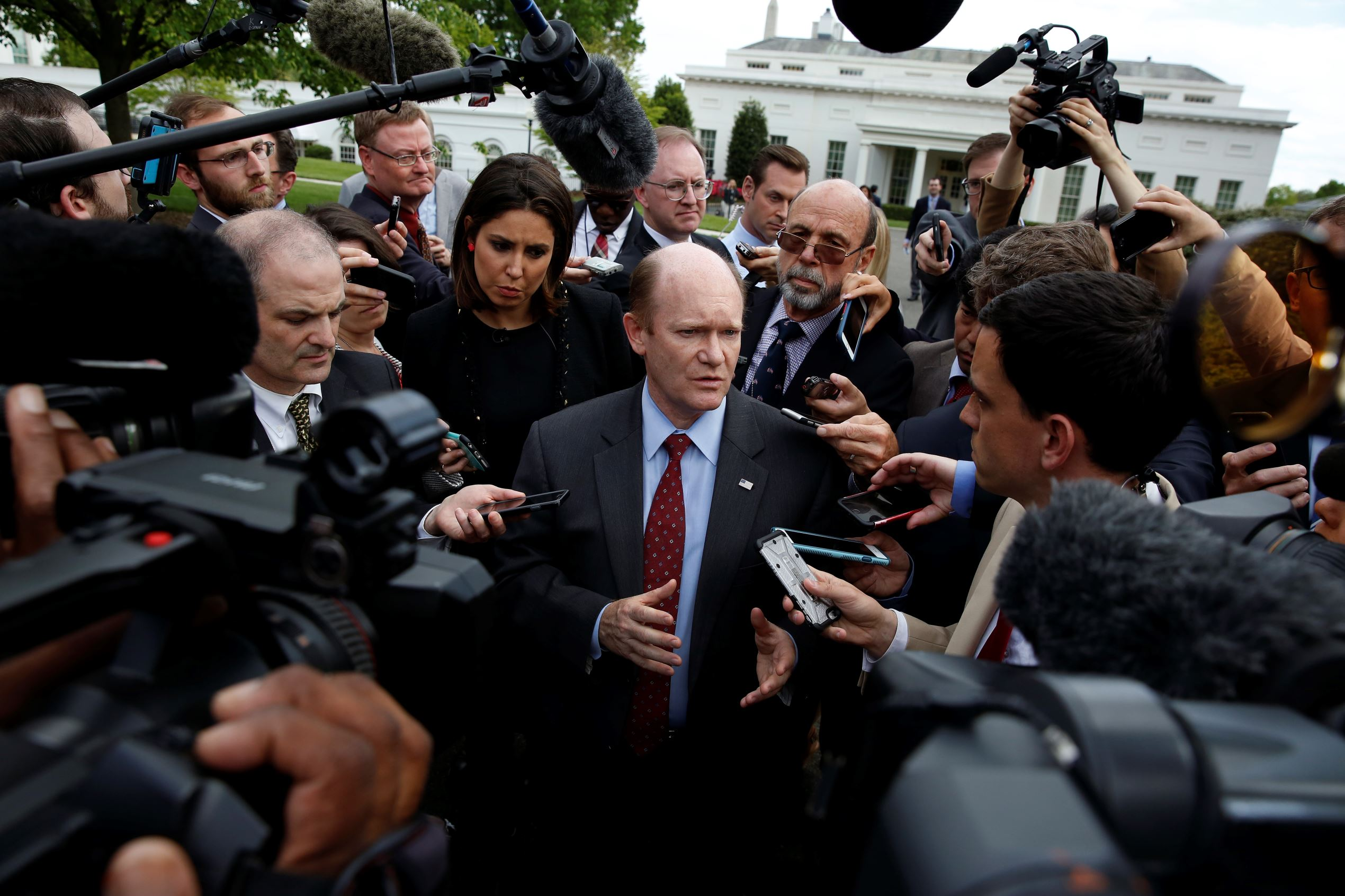 Sen. Chris Coons, D-Del., talks with reporters after an all Senators briefing on the Democratic People's Republic of Korea at the Eisenhower Executive Office Building on the White House complex, Washington, Wednesday, April, 26, 2017.