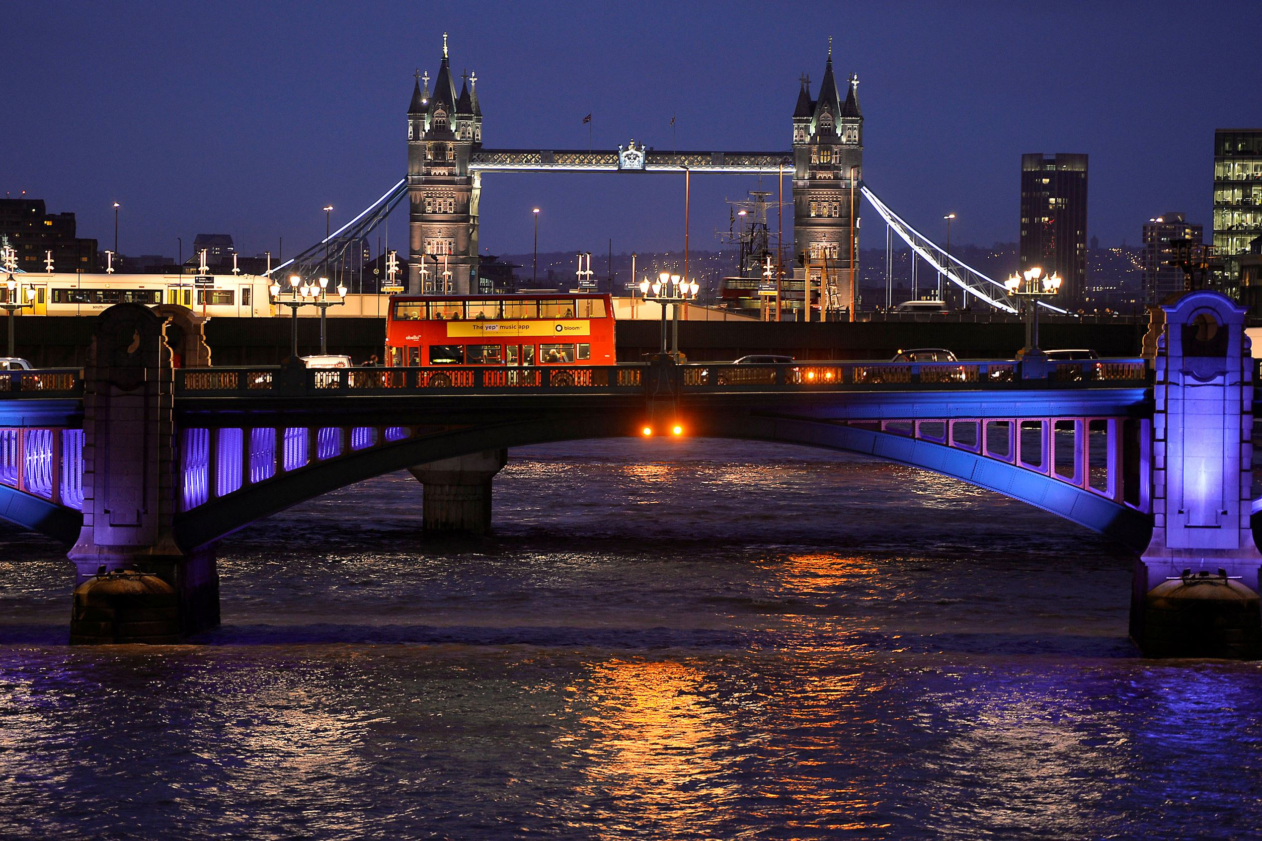 Slide 16 of 16: File photo of a London bus crosses the River Thames on London Bridge during the evening rush hour with Tower Bridge seen behind in London.