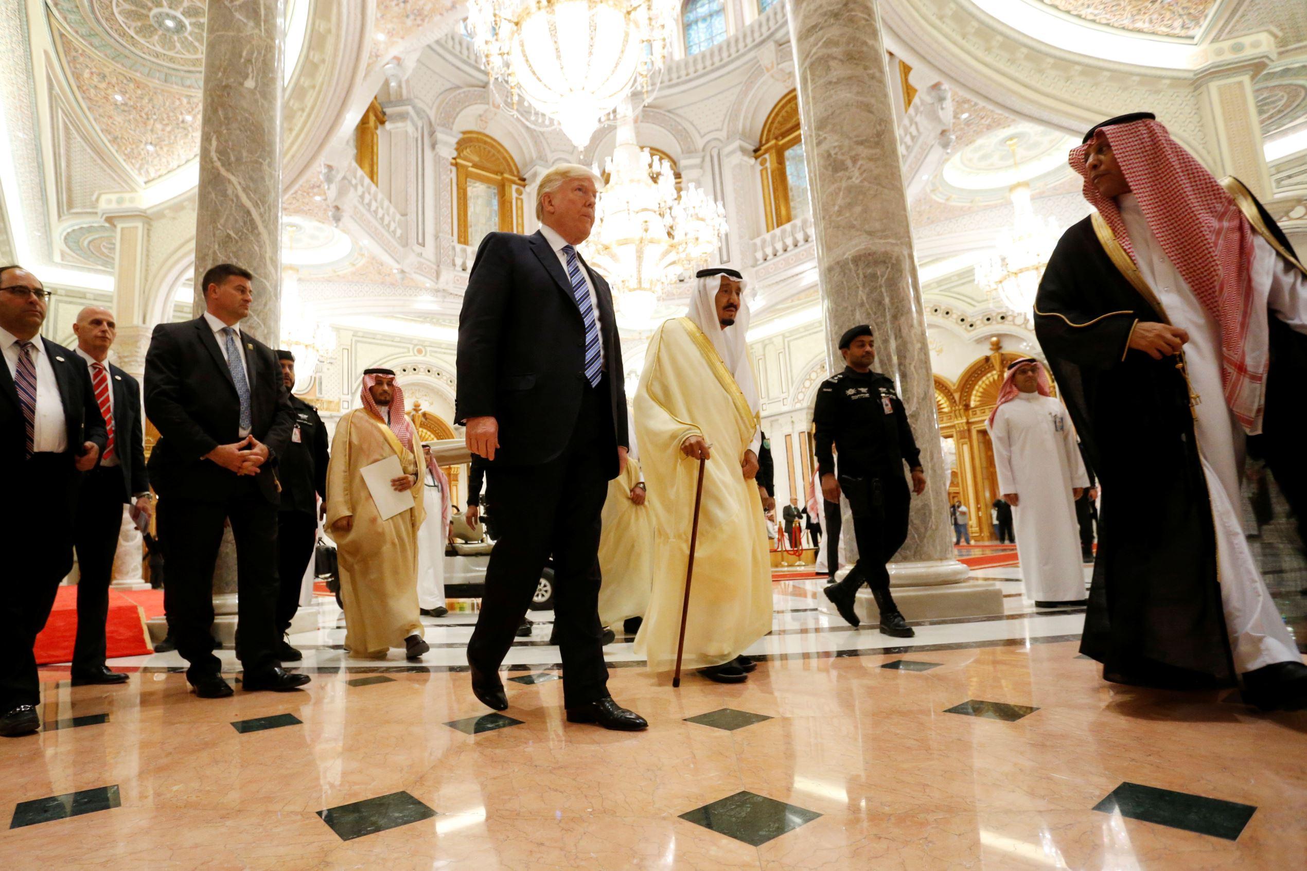 U.S. President Donald Trump (center L) walks with Saudi Arabia's King Salman bin Abdulaziz Al Saud (center R) to deliver remarks to the Arab Islamic American Summit in Riyadh, Saudi Arabia May 21, 2017.