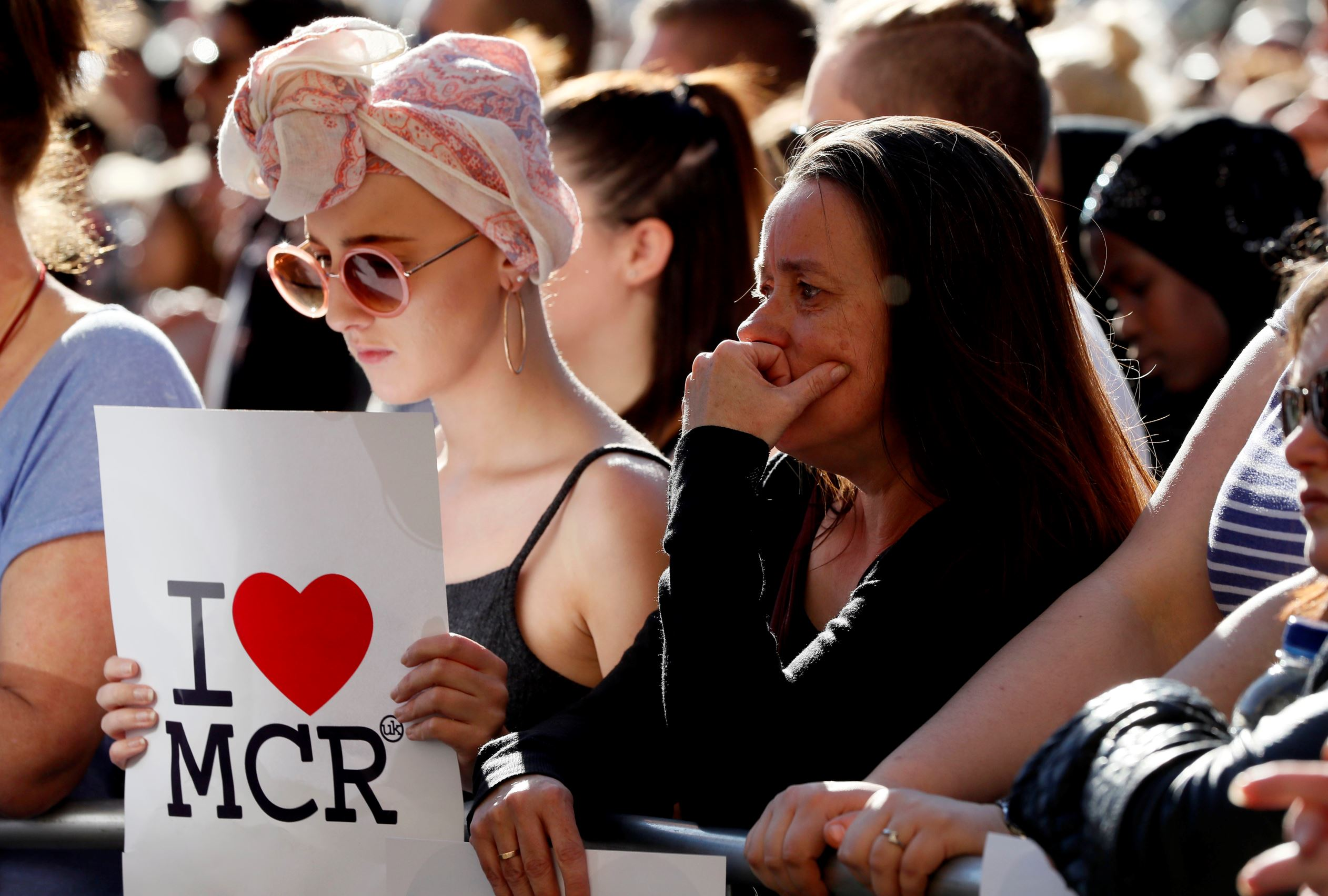 Slide 4 of 48: People attend a vigil in Albert Square, Manchester, England, Tuesday May 23, 2017, the day after the suicide attack at an Ariana Grande concert that left 22 people dead as it ended on Monday night.