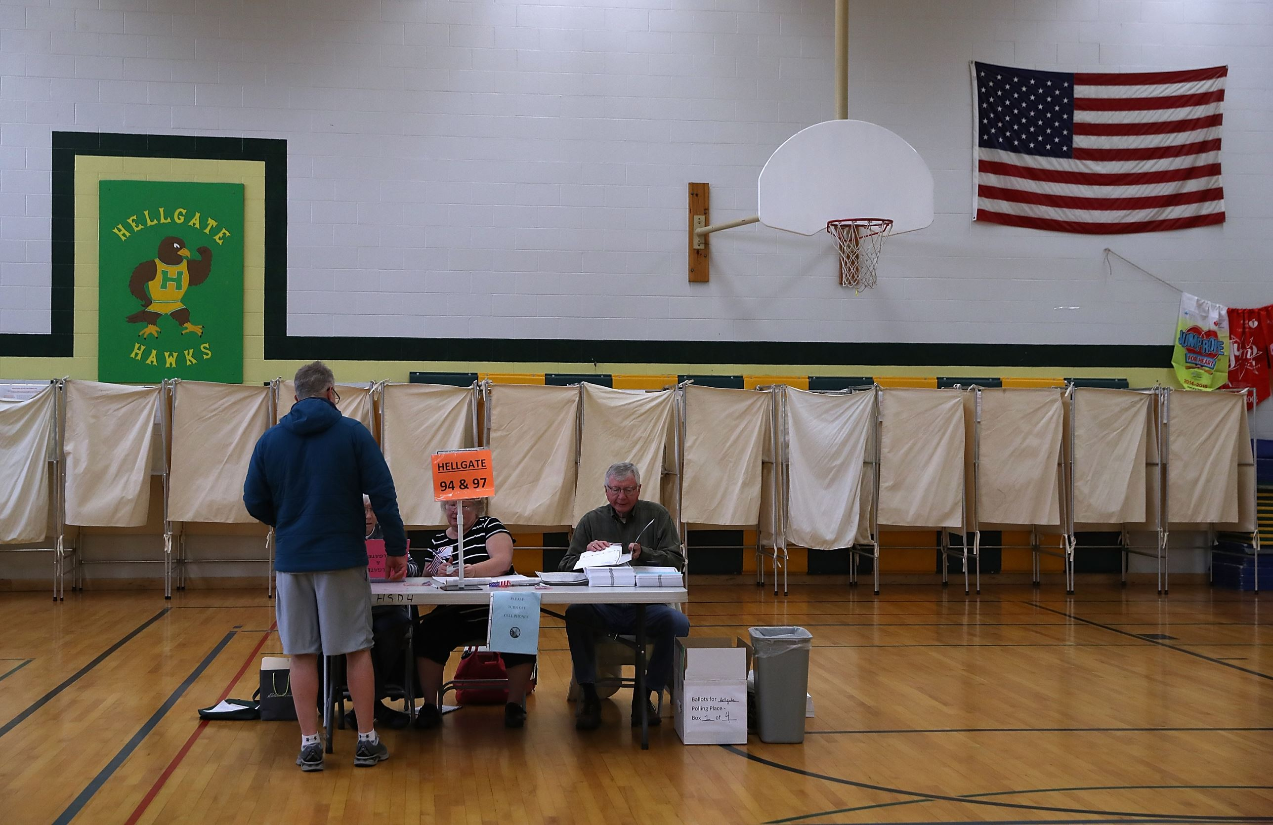 A voter registers in a polling station at Hellgate Elementary School on May 25, 2017 in Missoula, United States.